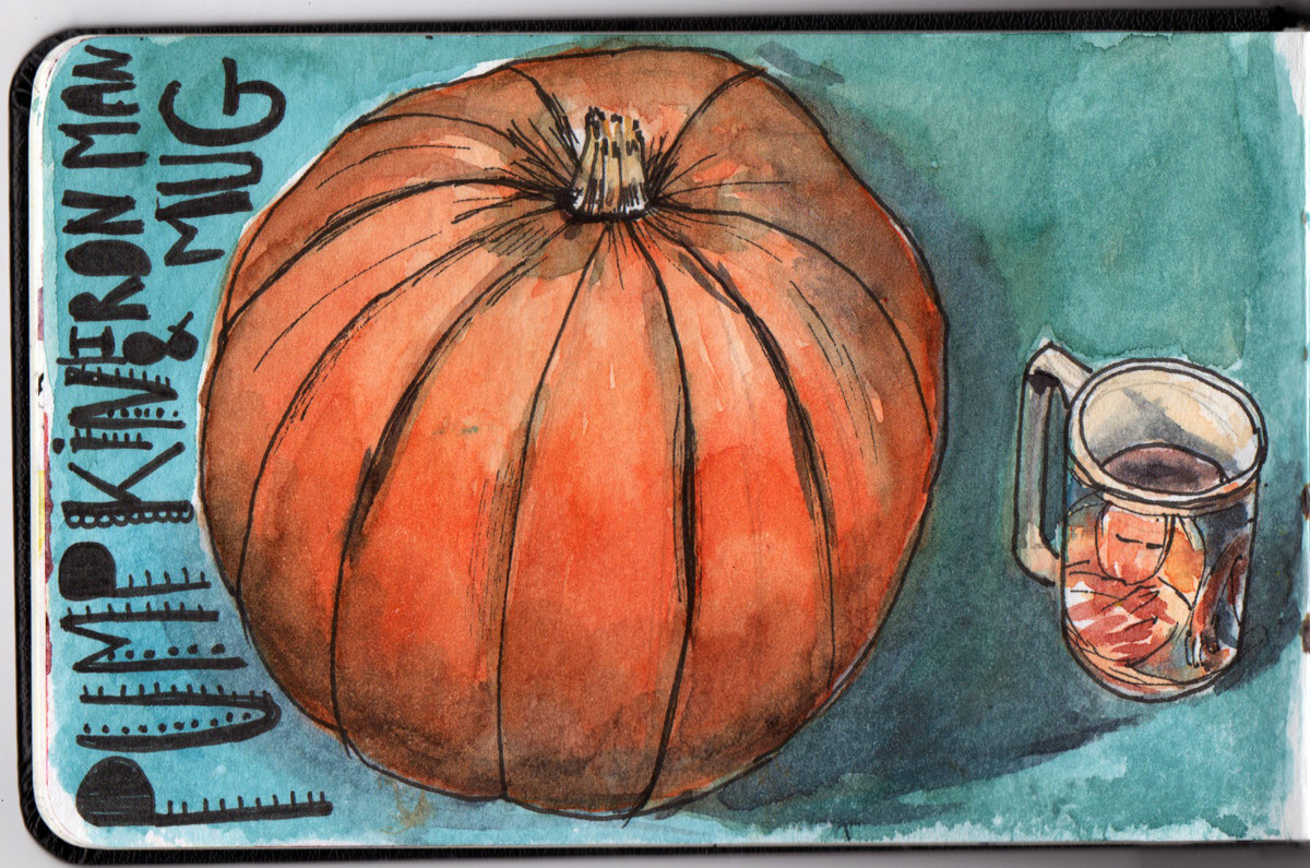 Halloween pumpkin in watercolour and pen in small Moleskin Sketch Book