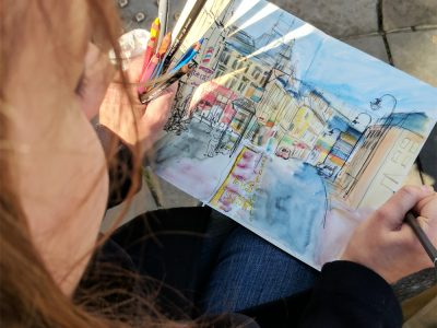 Sophie Peanut (Baxter) drawing in her sketchbook